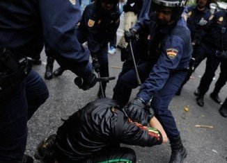 Police have fired rubber bullets and baton-charged Spanish protesters attending Occupy Congress rally against austerity in Madrid