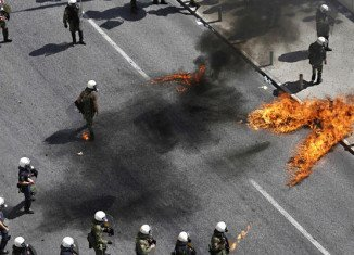Police have fired tear gas in Greece to disperse anarchists throwing petrol bombs near parliament in Athens