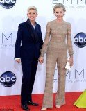 Portia de Rossi opted for something more masculine, posing with wife Ellen DeGeneres in an unusual Maison Valentino jumpsuit