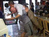 President Barack Obama was lifted in a bear hug by pizza shop owner Scott Van Duzer during a bus tour in Florida