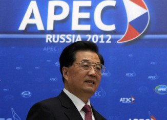 President Hu Jintao has promised to maintain economic growth to support a global recovery, at the start of APEC summit in Vladivostok