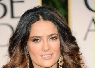Salma Hayek has admitted that she achieves her skin perfection by never washing her face when she wakes up in the morning