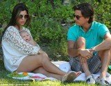 Scott Disick and Kourtney Kardashian covered their baby daughter Penelope in kisses as they took her to the park for a picnic
