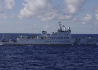 Six Chinese surveillance ships have entered waters near islands claimed by both Japan and China