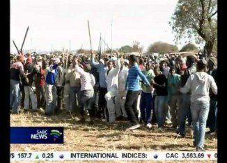 South African police have fired rubber bullets and tear gas to disperse protesters near a mine owned by Anglo American Platinum