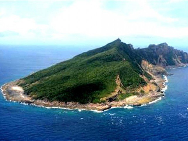 Two Chinese patrol ships have been sent to islands disputed with Japan, which has sealed a deal to purchase the islands
