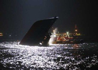 A rescue operation is continuing for passengers still missing five hours after a boat half-sank following Monday night's collision near Lamma island