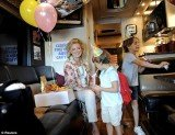 Ann Romney is campaigning for her husband on a bus tour through the swing state with her two grandsons, Parker and Miles