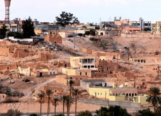 At least 22 people have died in days of fighting in Libya's town of Bani Walid