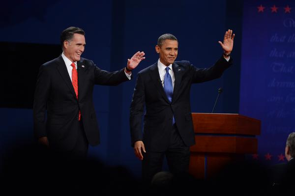 Barack Obama and Mitt Romney have clashed over their economic plans at Denver debate