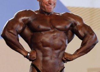 Bodybuilder's head literally paled in comparison to his super-bronzed body as he flexed his muscles for the judges