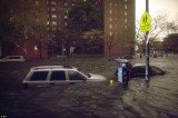 Cars were swept down streets and power was cut across lower Manhattan in a bid to minimize damage to infrastructure