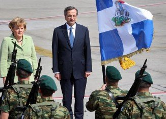 Greek Prime Minister Antonis Samaras welcomes German Chancellor Angela Merkel