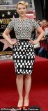 If you are bigger up top like Scarlett Johansson, pick a dress with a bolder print on the bottom half
