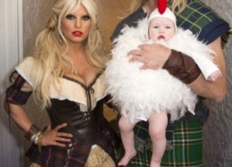 Jessica Simpson opted for a racy Halloween costume that showed off her newly slimmed-down waist