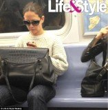 Katie Holmes rides the subway