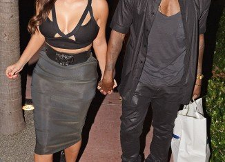 Kim Kardashian's famous hourglass figure has grown by 28 lbs since she started dating Kanye West