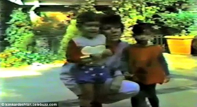 Kim and Kourtney Kardashian with mother Kris, seen in a home video from Halloween in 1982
