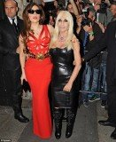 Lady Gaga looked sensational as she displayed her curves in a red Versace dress in Milan