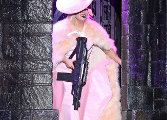 Lady Gaga showed off a machine gun at her audience as she performed in Milan
