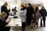 Lithuania is voting in the second round of national elections, with budget cuts and joining the euro seen as key issues