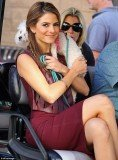 Maria Menounos showed her affection for an adorable little dog as she carried the perky pooch in her arms around the set of Extra