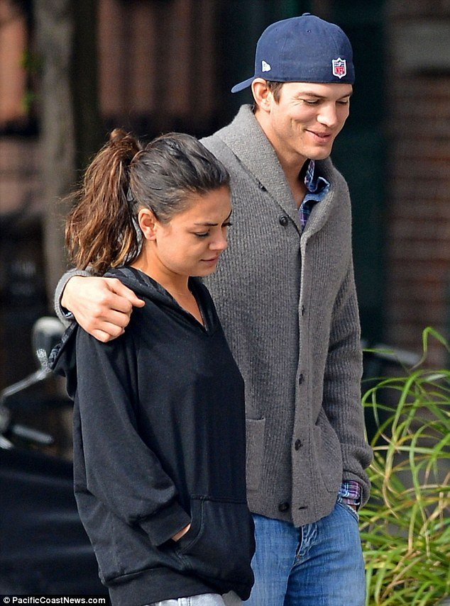Mila Kunis appeared to have rolled out of bed in her pyjamas as she went on a coffee run with boyfriend Ashton Kutcher make-up free
