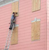 New Jersey people board up their homes in preparation for Hurricane Sandy