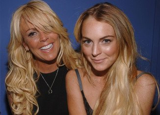 "Police were called after Lindsay Lohan got into a ""violent fight"" with her mother Dina"