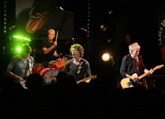 The Rolling Stones have performed to 350 fans at Le Trabendo club in Paris after announcing a surprise gig on Twitter