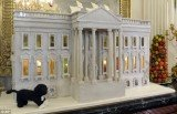 A 300 lbs gingerbread replica of the White House was the centrepiece of the White House Christmas decorations, unveiled Wednesday by First Lady Michelle Obama