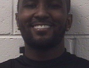 A newly-released booking photo of Nick Gordon shows him smiling following his arrest for reckless driving