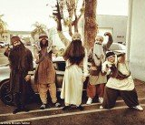 Chris Brown dressed as gun toting Taliban terrorist at Halloween party