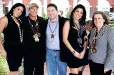 Jill Kelley and her twin sister Natalie Khawam pictured with David Petraeus and his wife