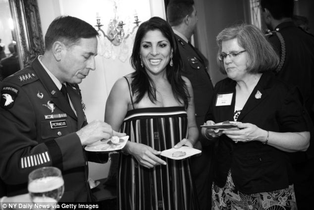 Jill Kelley with General David Petraeus and his wife Holly at her home in 2011
