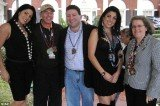 Jill Kelley's twin sister Natalie Khawam, David Petraeus, Scott and Jill Kelley, and Holly Petraeus watch the Gasparilla parade from the Kelley family's front lawn in 2010