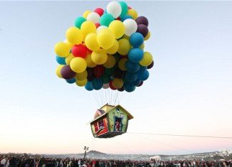 Jonathan Trappe, a cluster-balloonist who became the first person to fly the English Channel, has launched a house into the sky just like in the Disney movie Up