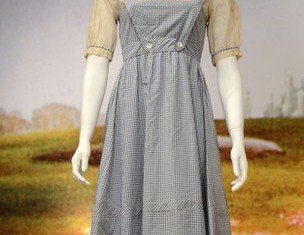 Judy Garland's dress worn in the Wizard of Oz has sold for $480,000 at auction in Beverly Hills