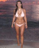 Kim Kardashian paraded her stunning curves in a pretty light pink string bikini as she took a morning dip earlier this month in Miami