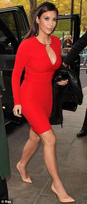Kim Kardashian stopped traffic as she showed off her curvy body in the red Kardashian Kollection dress in London