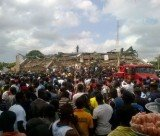 Melcom department store has collapsed in Ghana's capital, Accra, with dozens of people believed to be trapped inside