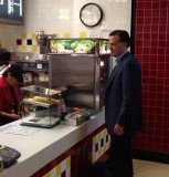 Mitt Romney was spotted picking up a snack in a McDonald's restaurant just ahead of a lunch in the White House with Barack Obama on Thursday