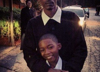 Natina Reed's ten-year-old son, Tren Brown, bravely attended his mother's funeral while standing wrapped in his father's arms