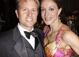 Paula Broadwell looks determined to prove that her marriage is back on track following the highly public fallout over her affair with ex-CIA chief General David Petraeus