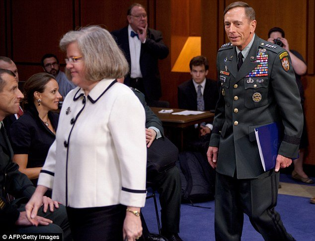 Paula Broadwell was caught gazing at David Petraeus as he entered a congressional hearing with his wife Holly in a photograph from 2011