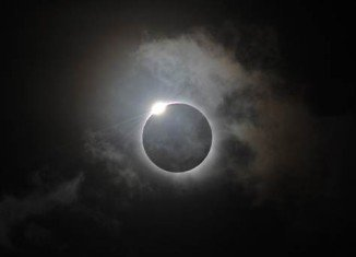 Tens of thousands of tourists and astronomers gathered in Queensland, northern Australia, to glimpse a rare total solar eclipse