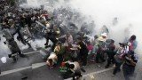 Thai police have used tear gas against thousands of protesters calling for the overthrow of Prime Minister Yingluck Shinawatra in Bangkok