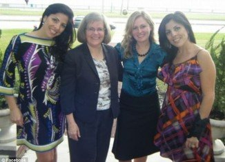 Twin sisters Jill Kelley and Natalie Khawam pose with David Petraeus' wife, Holly, and daughter, Anne