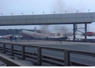 A Russian passenger plane has crashed into a main road outside Moscow, killing at least four people