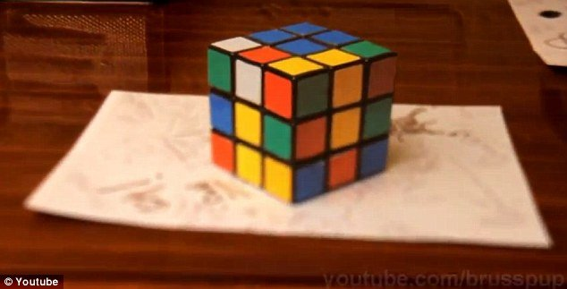 A new video on YouTube shows how what appears to be a fully formed Rubik's cube is in fact a two dimensional color drawing that tricks the brain into believing it has three dimensions